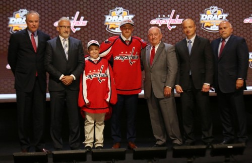 Jun 27, 2014; Philadelphia, PA, USA; Jakub Vrana poses for a photo with team officials after being selected as the number thirteen overall pick to the Washington Capitals in the first round of the 2014 NHL Draft at Wells Fargo Center. Mandatory Credit: Bill Streicher-USA TODAY Sports