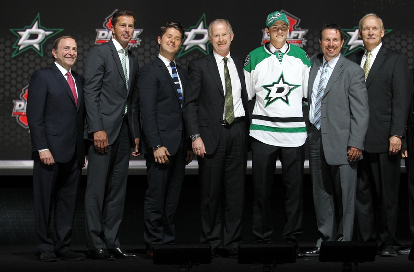 Jun 30, 2013; Newark, NJ, USA; Jason Dickinson poses for a photo with team officials after being introduced as the number twenty-nine overall pick to the Dallas Stars during the 2013 NHL Draft at the Prudential Center. Mandatory Credit: Ed Mulholland-USA TODAY Sports