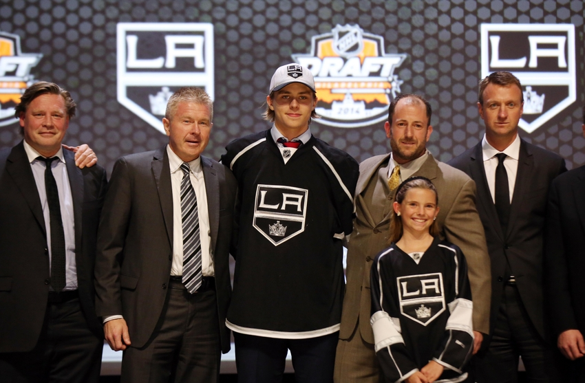 Jun 27, 2014; Philadelphia, PA, USA; Adrian Kempe poses for a photo with team officials after being selected as the number twenty-nine overall pick to the Los Angeles Kings in the first round of the 2014 NHL Draft at Wells Fargo Center. Mandatory Credit: Bill Streicher-USA TODAY Sports