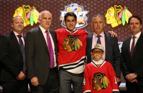 Jun 27, 2014; Philadelphia, PA, USA; Nick Schmaltz poses for a photo with team officials after being selected as the number twenty overall pick to the Chicago Blackhawks in the first round of the 2014 NHL Draft at Wells Fargo Center. Mandatory Credit: Bill Streicher-USA TODAY Sports