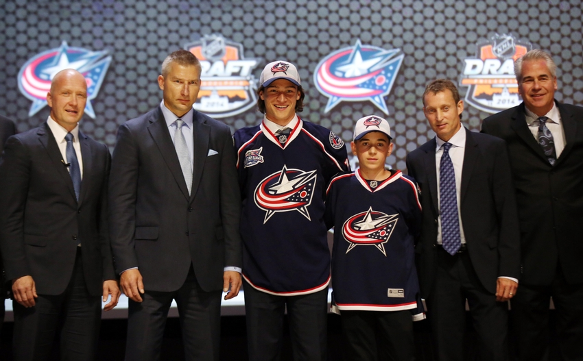 Jun 27, 2014; Philadelphia, PA, USA; Sonny Milano poses for a photo with team officials after being selected as the number sixteen overall pick to the Columbus Blue Jackets in the first round of the 2014 NHL Draft at Wells Fargo Center. Mandatory Credit: Bill Streicher-USA TODAY Sports