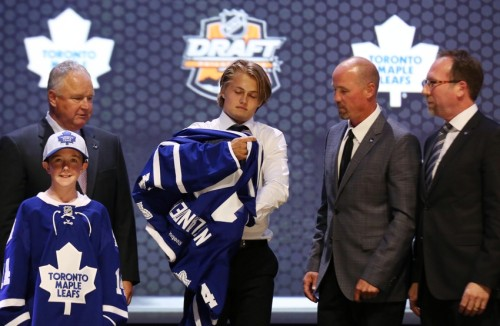 Jun 27, 2014; Philadelphia, PA, USA; William Nylander puts on a team sweater after being selected as the number eight overall pick to the Toronto Maple Leafs in the first round of the 2014 NHL Draft at Wells Fargo Center. Mandatory Credit: Bill Streicher-USA TODAY Sports