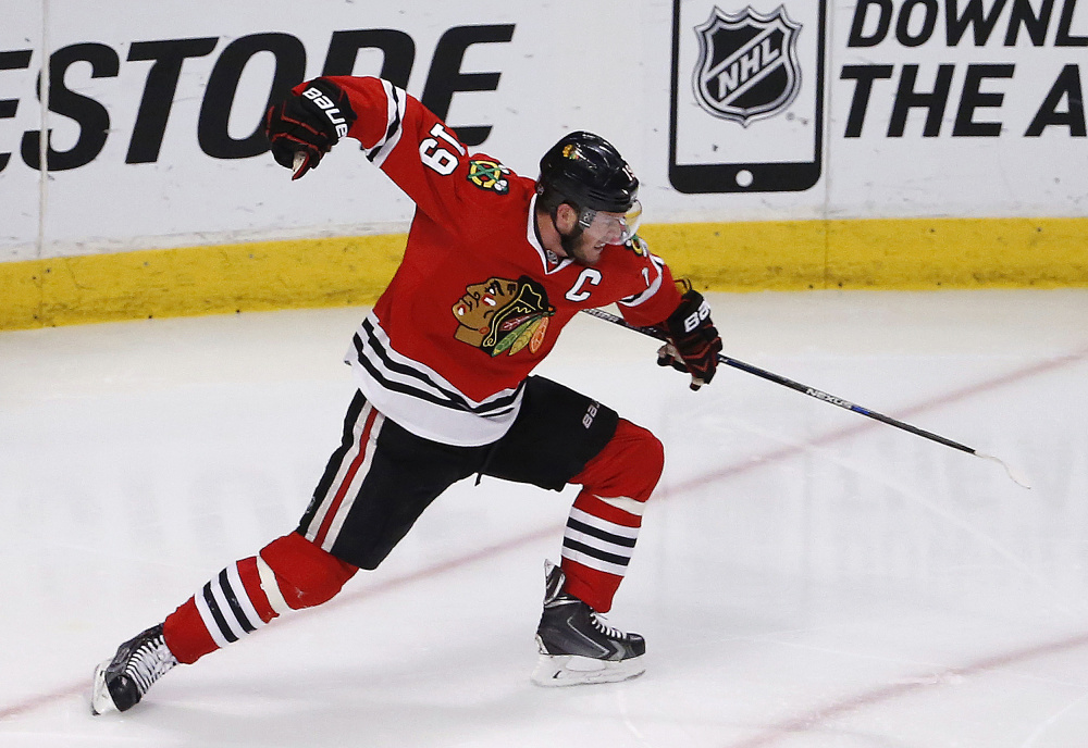 Chicago Blackhawks center Jonathan Toews celebrates his goal against the Anaheim Ducks during the third period in Game 4 of the Western Conference finals of the NHL hockey Stanley Cup playoffs, Saturday, May 23, 2015, in Chicago. (AP Photo/Charles Rex Arbogast) ORG XMIT: CXA140